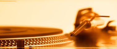 Golden turntable headshell and platter dots, macro view Royalty Free Stock Photo