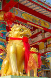 Golden twin kirin sculpture. In front of chinese shine Stock Photography
