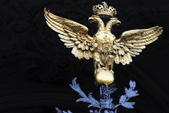 Golden two-headed eagle on Winter Palace gates. St. Petersburg Stock Photography