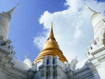 Golden and two white chedis of Royal cemetry at Wat Ratchabopit Royalty Free Stock Photography