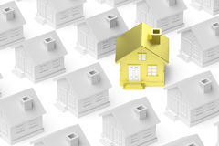 Golden unique house standing out from crowd of houses. Stock Photo