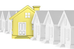 Golden unique house standing out from row of gray houses. Royalty Free Stock Photos