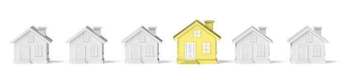 Golden unique house standing in row of gray houses Royalty Free Stock Photo