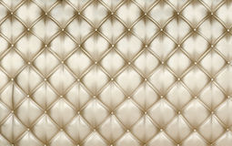 Golden upholstery background. Elegant golden upholstery - can be used as background or texture Stock Images