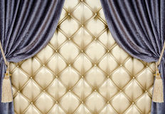 Golden upholstery with velvet curtain background Royalty Free Stock Photography