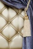 Golden upholstery velvet curtain background Stock Photo