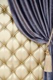 Golden upholstery velvet curtain background Royalty Free Stock Photos