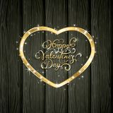 Golden Valentine heart with diamonds on black wooden background. Gold heart with diamonds and lettering Happy Valentines Day on black wooden background Royalty Free Stock Images