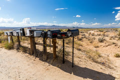 GOLDEN VALLEY, ARIZONA. SEPTEMBER 6: Views of mail boxes along the highway 93 on September 6, 2015. Mail boxes are popular photographic motives by tourist Stock Images
