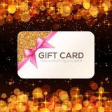 Golden vector gift card with pink ribbon and bow Royalty Free Stock Images