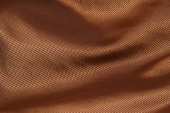 Golden velvet fabric folded background Stock Photo