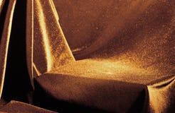 Golden velvet pedestal. Golden-shine velvet drapery pedestal Stock Photography