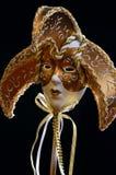 Golden Venetian Mask. On black royalty free stock photo