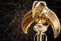 Golden Venetian Mask. With fireworks royalty free stock image