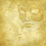 Golden Venetian mask on floral grunge texture Stock Photo