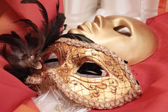 Golden venetian masks Stock Images
