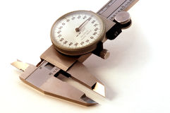 Golden Vernier. Close up of vernier caliper - golden hue - on white royalty free stock image