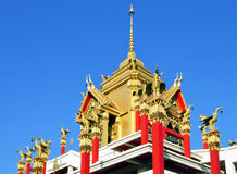 Beautiful temple, red poles, blue sky, Thailand Stock Image