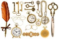 Golden vintage accessories. Antique keys, clock, glasses, scissors, compass. Collection of golden vintage accessories. antique keys, clock, compass, scissors stock photo