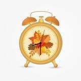 Golden vintage alarm clock with autumn leaves. Vector illustration stock illustration