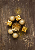 Golden Vintage Balls and Gifts with Glitter on Wooden Background Stock Photography