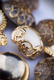 Golden vintage button. Gold and mother-of-pearl vintage button Royalty Free Stock Photography