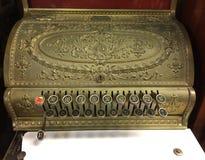 A golden vintage cash register stock image