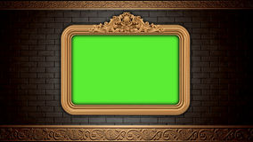 Golden vintage frame on brick wall.  Design retro element. Green screen Stock Photography
