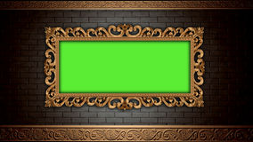 Golden vintage frame on brick wall.  Design retro element. Green screen Stock Photography