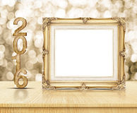 Golden Vintage frame with 2016 year wood texture with sparkling Stock Photos