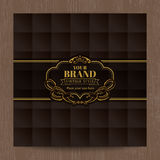 Golden vintage oval frame on brown square grid pattern  Royalty Free Stock Images