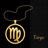 Golden Virgo Necklace. Golden embossed horoscope symbol, necklace and gold chain, for the astrology Earth Sign, Virgo, textured black background Royalty Free Stock Photo