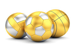 Golden volleyball, basketball and soccerball Stock Photos