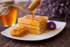 Golden waffle and sweet honey for breakfast. Background Stock Images