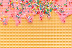 Free Golden Waffle Texture With Pink Icing And Sprinkles, Background For Your Design Royalty Free Stock Images - 152813499