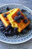 Golden waffles with black blackberries Royalty Free Stock Image