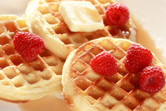 Golden waffles and raspberries Royalty Free Stock Photo
