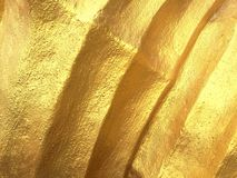 Golden wall. Curves texture Royalty Free Stock Image