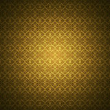 Golden wallpaper with heart-shaped ornaments Stock Images