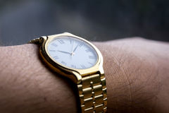 Golden watch Stock Photography