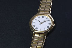 Golden watch Royalty Free Stock Image