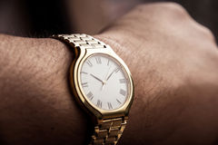 Golden watch Stock Photos