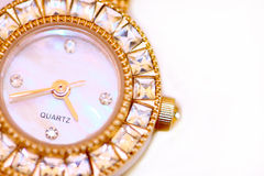Golden watch with diamonds. Macro Stock Images