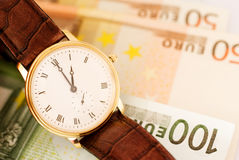 Golden watch on Euro banknotes Royalty Free Stock Photo