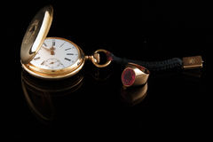 Golden watch and man�s ring Stock Photo