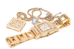 Golden watch, ring and necklace. royalty free stock images