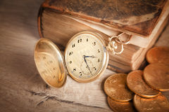 Golden watch and us dollars coins an book Royalty Free Stock Photos