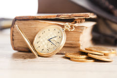 Golden watch and us dollars coins Stock Photo