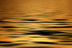Golden water Background Royalty Free Stock Image