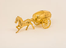 The Golden water-carrier. Golden horse carrying a Golden barrel on a light background royalty free stock photography